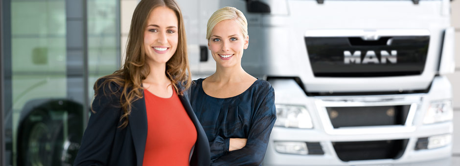 MAN Financial Services advisors in front of a white MAN truck