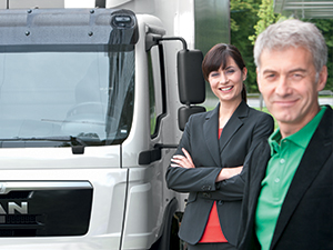 MAN Financial Services customer in front of a white MAN TGL truck